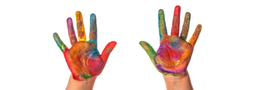Two small hands covered in various paint colors