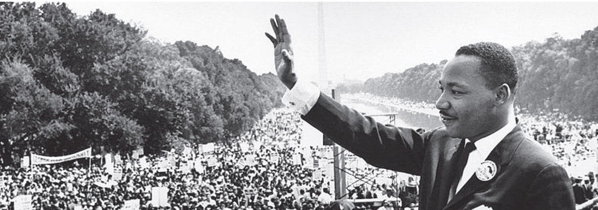 Martin Luther King Jr. waving to crowd during his famous speech