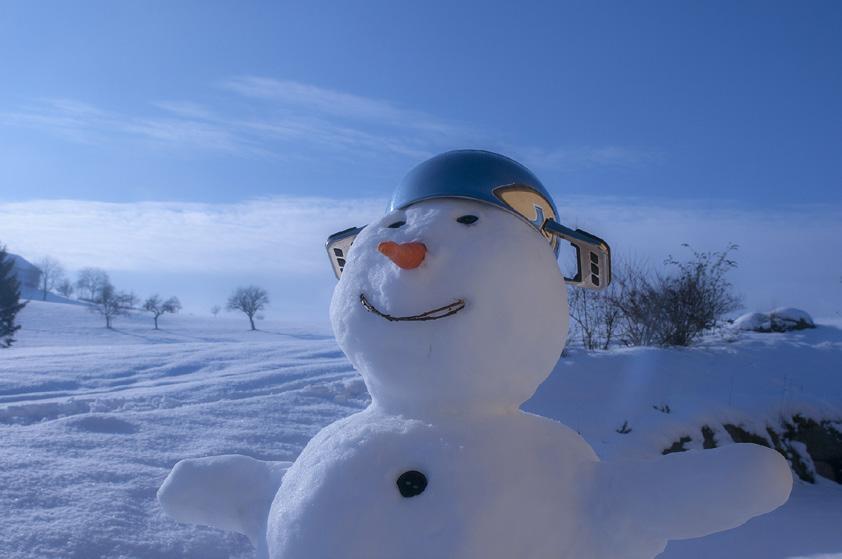 Snowman wearing a metal pot on its head