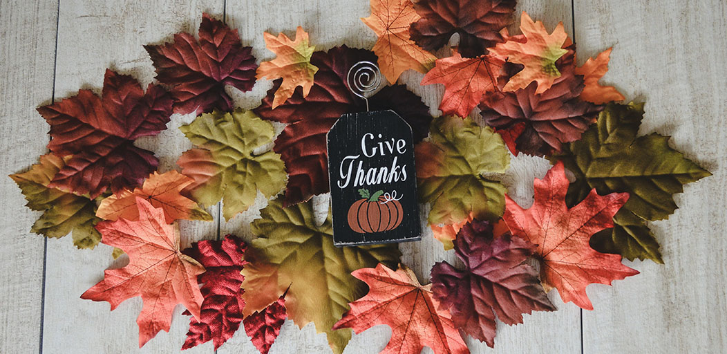 Give thanks surrounded by autumn leaves
